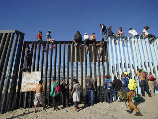 Migrants arrive in Tijuana, a few briefly cross into US before going back