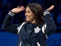 Canadian tennis player Bianca Andreescu waves to the crowd after dropping the ceremonial puck before an NHL hockey game between the Toronto Maple Leafs and the Boston Bruins in Toronto, Saturday, Oct. 19, 2019. (Fred Thornhill/The Canadian Press via AP)