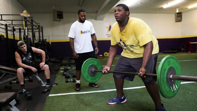 Kiyaunta Goodwin, 14, right, completes a set of bent over rows at Aspirations Fitness Institution ran by former U of L graduate and NFL player Chris Vaughn. Goodwin. Priority has been put on protecting Goodwin's still growing bones, so weights have been minimal. May 23, 2018