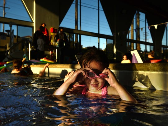 Gabrielle Woo is challenged by her goggles as she gets ready for a swim class at the Ventura Family YMCA.