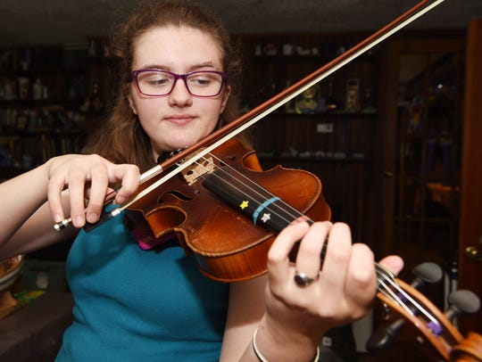 Cosette Veeder-Shave, 16, of Hyde Park, plays the fiddle