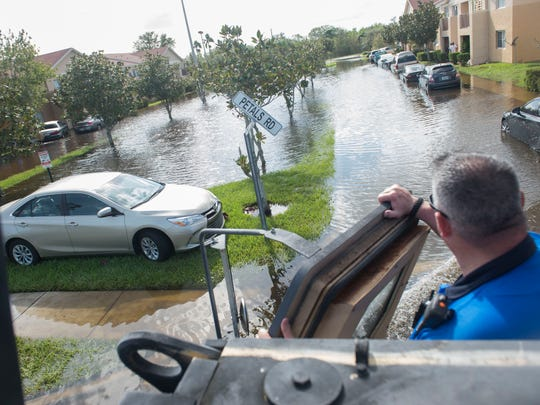 Officer Guy Montgomery examines the flooded Sabal Chase Apartments in the Fort Pierce police's Mine-Resistant Ambush Protected military vehicle following Hurricane Irma on Monday, Sept. 11, 2017, in Fort Pierce.