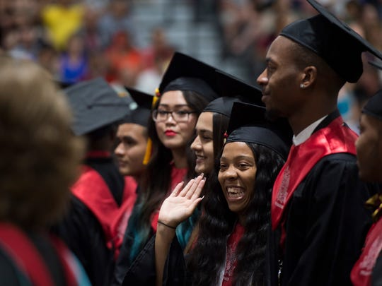Graduate Kyla Bruno, 18, of Port St. Lucie, waves to the crowd as Port St. Lucie High School graduated 393 students Tuesday, May 22, 2018 during the commencement ceremony at the Havert L. Fenn Center in Fort Pierce. The event included speeches by class president Jane Badio, salutatorian Molly Thomas and valedictorian Kelly Nguyen and performances by the PSLHS chorus and band.