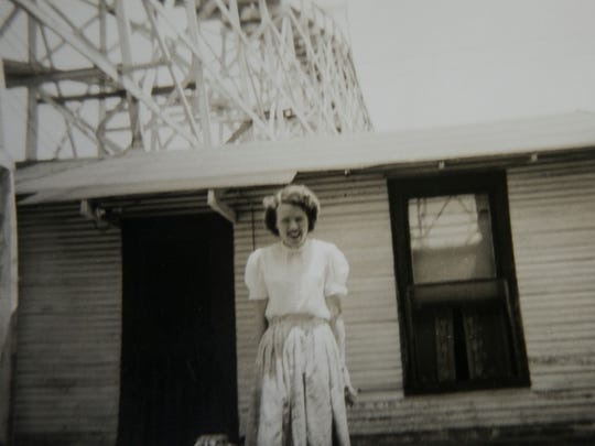 Glen Coleman's parents, Bob and Laura Coleman, lived in a house that apparently was at the base of the Pippin from 1946 to 1960. In this image, Laura Coleman poses for a photo in front of her home. The Pippin was the famous Memphis wooden roller coaster near the old Fairgrounds.