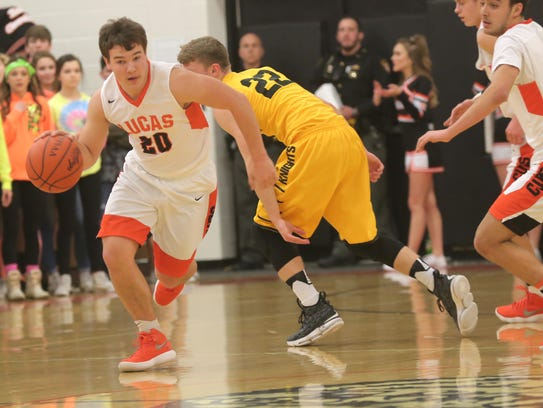 Lucas' Jeb Grover dribbles the ball while playing a