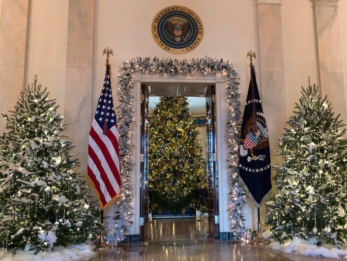 The official White House Christmas tree, center, is