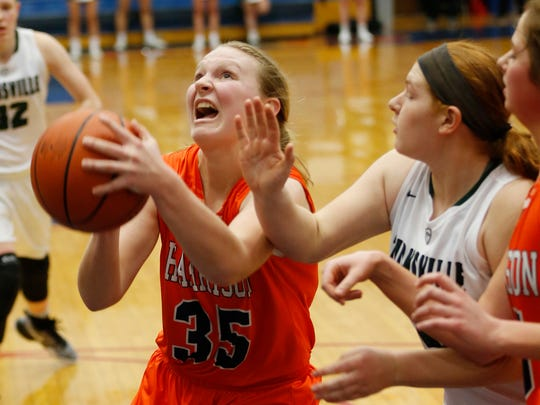 Harrison's Olivia Stansbury drives to the basket against