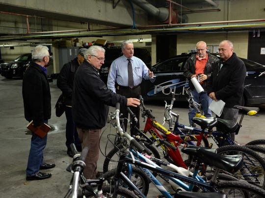 Michael W. Reaves, Port Huron director of Public Safety gives bikes to numerous charities Thursday, Dec. 18 at the Port Huron Municipal Office Center.