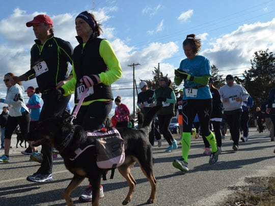 Racing in the 18th annual 5k Run for the Schooner are Jeff Dunlap of Pittsgrove, Lisa Crager of Vineland with her dog Mandi and Meghan Wren, executive director of the Bayshore Center at Bivalve. Photo/Jodi Streahle