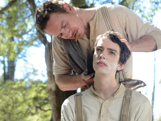 "Kodi Smit-McPhee (right) and Michael Fassbender star in the unusual Western, ""Slow West."""