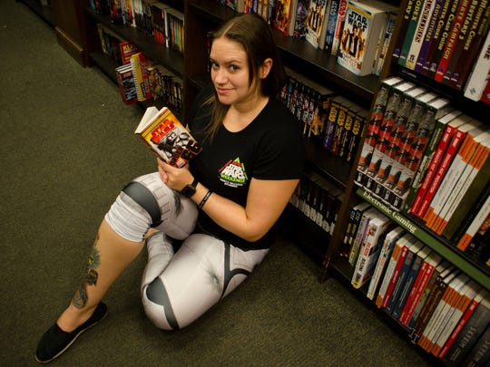 "Amber Nussbaumer-Varley of Pace checks out the ""Star Wars"" books for sale at Barnes & Noble in Pensacola. Barnes & Noble will celebrate ""Fangirl Friday"" this week."