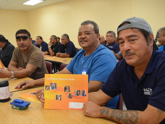 150 community members attended Safetalk, a suicide prevention class, on Aug. 7, 2015. From left: Tamuning Substation school bus drivers Thomas Carbullido, Robert Leon Guerrero and Roque Santos.