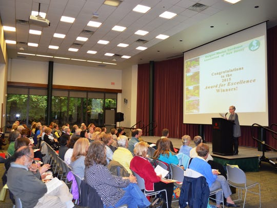 At the podium, Ellen Simonetti, President of the Rutgers Master Gardener Association of NJ and Rutgers Master Gardener of Monmouth County, welcomes the annual conference attendees and all 2015 Awards for Excellence winners.