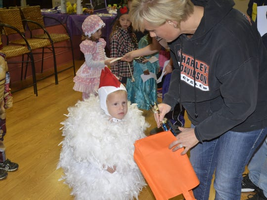 Salem Sprenger, 2, won top prize Saturday in the toddler group at the downtown Fremont Farmers Market costume contest.