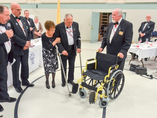 The Knights of Columbus present a wheelchair to Veteran