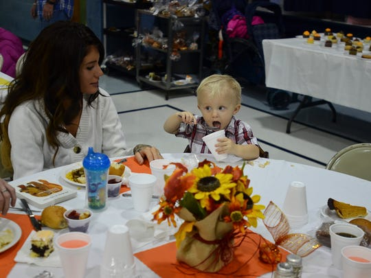 Samantha Starbuck and her son Marcus enjoy a meal together at a past Salvation Army Thanksgiving community dinner.
