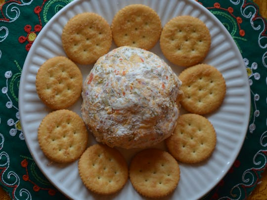 This cheeseball makes an excellent hostess gift. The creamy cheese, salty olives and sharp cheddar are an excellent combination. It keeps, refrigerated, for up to five days.