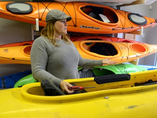 Missy Campau talks about having her dream location Monday, Dec. 7, at her new store, Missy's Kayak Connection, in Port Huron along the Black River.