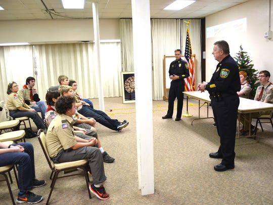 Iowa City Police Chief Sam Hargadine, foreground, and