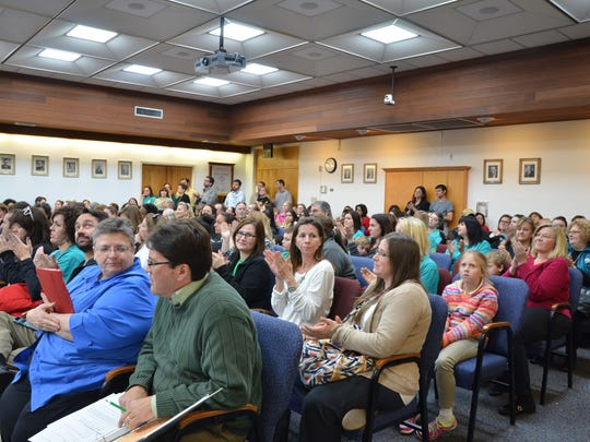 Dozens of Lafayette parents and teachers attend a Lafayette Parish School Board meeting about proposed Schools of Choice changes. The popular program allows students to attend schools with specialized instruction, such as in the arts, technology, health care, language immersion and more.