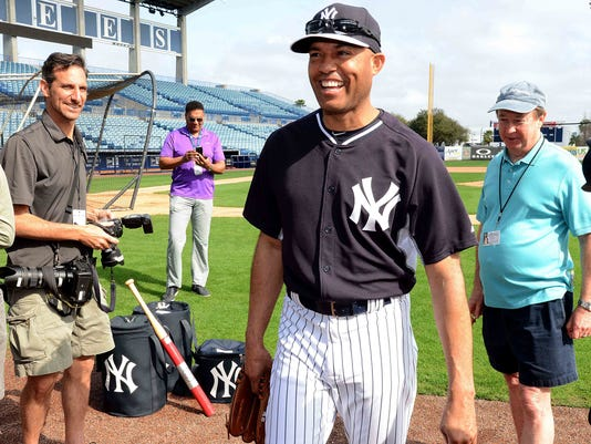 75927ae106e37 MLB  New York Yankees-Workout. Yankees guest instructor Mariano Rivera  walks toward the ...