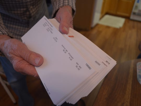 Cedar Rapids resident James Robertson kept every pay stub from during nearly 30 years he worked at a furniture store where federal officials say where federal officials said he was misclassified as a contract worker.