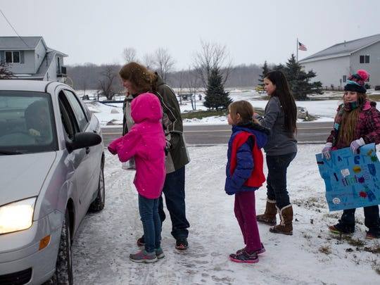 Members of Frontier Girls/Quest Club of Avoca collect donations to help Flint residents.