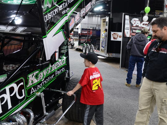 Chase Buscaglia, 7, gazes at Matt Campbell's sprint car at the Susquehanna Speedway booth with his father John Wilbert of Montgomeryville during Sunday's 2016 Motorsports Show at the Greater Philadelphia Expo Center.