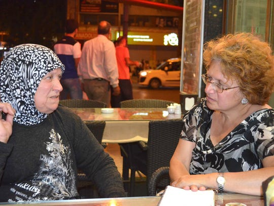 Mary D'Ambrosio interviews a Syrian refugee, who fled
