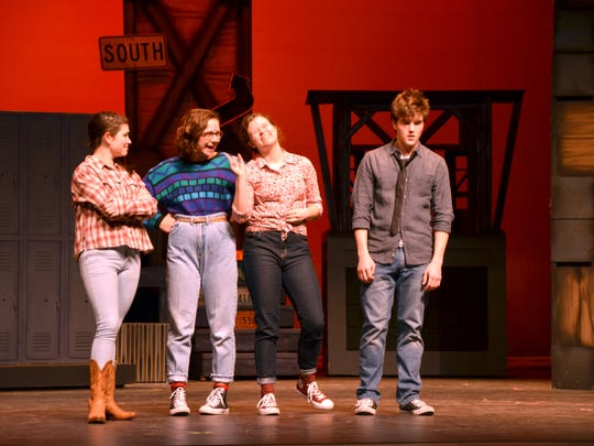 """Ben Tyrrell, right, stands with cast members of """"Footloose"""" during CYT's rehearsals Tuesday at Angelle Hall."""