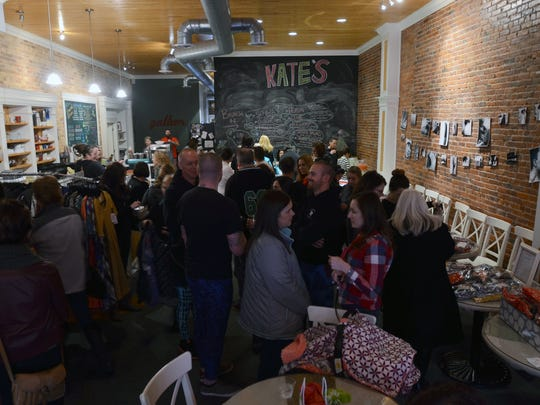 People fill the room Sunday, Jan. 31, during a boutique pop-up shop featuring LuLaRoe clothing by Suzy and Steph at Kate's Downtown.