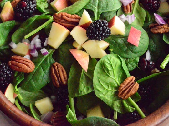 Spinach, apples, pecans, onion, and blackberries are