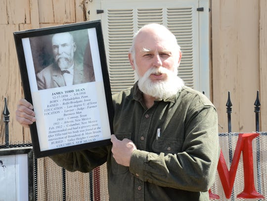 Tom Dean shows a picture of his great-grandfather James
