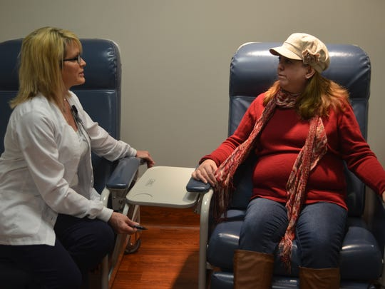 Holm, on March 1, 2016, speaks with Julia Burke, a certified nuclear medical technician at Methodist Hospital in Des Moines.