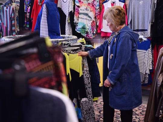 Judy Rancilio looks through the clothing items at Suzanne's