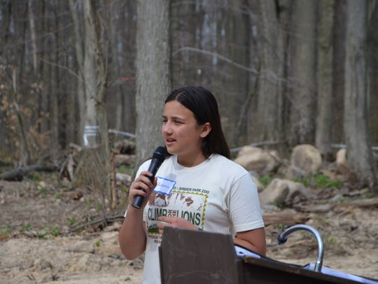 Yasmin Pirbhai of Kalamazoo talks about why she raised $15,000 for the new lion exhibit at Binder Park Zoo during a groundbreaking ceremony Wednesday.