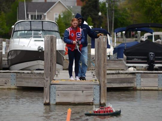 Laikyn Kulman, 15, of St. Clair, controls an RC boat