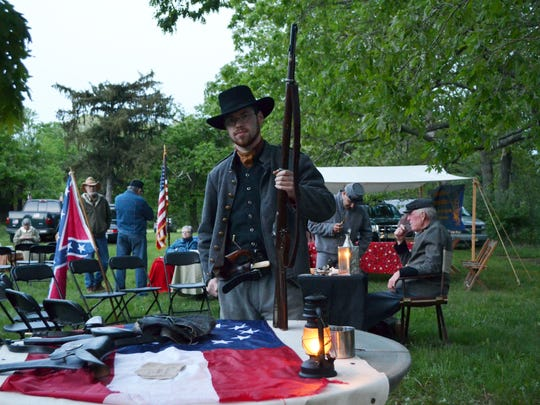 Josh Berge of Carmel, a member of the Ninth Virginia Calvary, displayed a collection of Civil War artifacts during the Founder's Day Camp by Candlelight on Friday, May 20 in Vineland. Photo/Jodi Streahle
