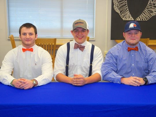Travelers Rest seniors, from left, David Jackson, Dawson Campbell and Dalton Moody signed to play football at Carson-Newman University.