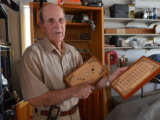Moisy Budoin shows pieces of an accordion made from