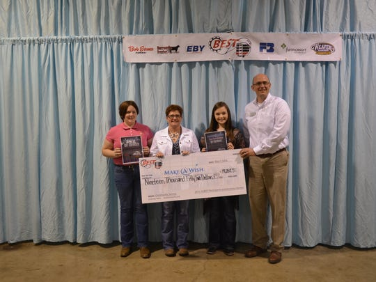 BEST Participants raised $19,052 for Make-A-Wish®, reaching their $16,000 goal. Abigail Thornton, Amanda, Ohio was the top fundraiser for Make-A-Wish® and was awarded a $500 Weaver Leather Livestock gift certificate. Participants raising $50 or more were also entered to win a $500 gift certificate, and Megan Becker, Whipple, Ohio was selected as the drawing winner. Pictured from left are Megan Becker, Whipple, Ohio; Jennie Rogers, Sidney, Ohio; Abigail Thornton, Amanda, Ohio; and John Hykes, Make-A-Wish. Jennie's son, Seth, was granted a wish and enjoyed working with cattle alongside his family. A trophy was presented in memory of him at the Celebrity Showdown in February.