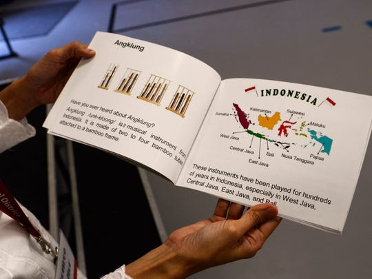 Indah Erdman, a volunteer at Monroe Elementary School, displays a book explaining the background, making and technique of the angklung. Erdman moved to Manitowoc from Java, Indonesia, last summer and was in charge of bringing the angklung into Monroe classrooms.