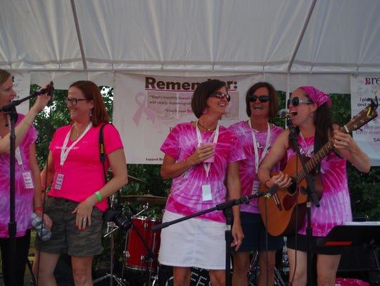 BreastFest organizer Sara O'Brien (far right) sings