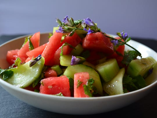This Cucumber Watermelon Salad with Mint and Grand Marnier Dressing is sweet, refreshing and spectacular. The sage blossoms are optional but make an incredible garnish.