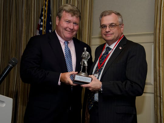 """John S. Fitzgerald, president and chief executive officer of the New Brunswick-based Magyar Bank, received the Distinguished Citizen Award from the Boy Scouts of America at their annual gala held recently at the Imperia in Somerset. The Boy Scouts of America (BSA) serves 20,000 youths in North and Central Jersey between the ages of 7 and 20 and is the nation's foremost youth program of character development and values-based leadership training. Fitzgerald (left) is presented the Distinguished Citizen Award by Garrick Stoldt, CFO, Saint Peter's Healthcare System and the 2016 Distinguished Citizen Award event chairman. """"The Boy Scouts learn valuable lessons through their Scouting activities, and develop a commitment to community that will prepare them to become successful leaders,"""" Fitzgerald said. """"At Magyar Bank, we strive to be an active member of the communities we serve, and it's very encouraging to see these young men develop a sense of community pride at a very young age."""""""