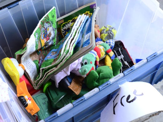Free items are offered at a garage sale on Buckland Avenue on Friday afternoon. A permit-free citywide garage sale is this weekend in Fremont, from Friday through Sunday.