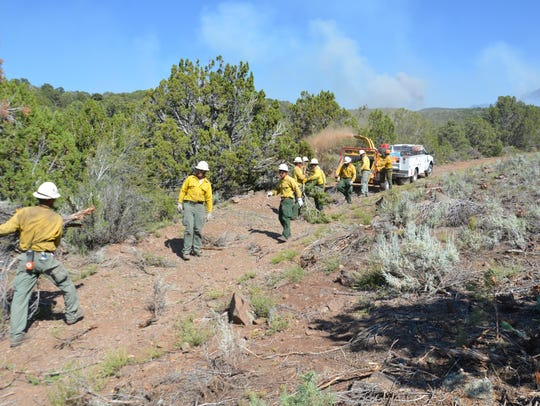 Fire crews work to strengthen the defenses around Pine