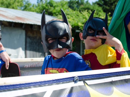 T.J. Donovan's son, Jack, and nephew, J.P., strike superhero poses while riding on the Vermont Justice League float in the Bristol Independence Day parade on July 4, 2016