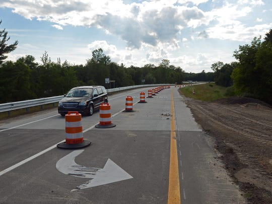 A vehicle gets off the Taylor Road exit Sunday, July