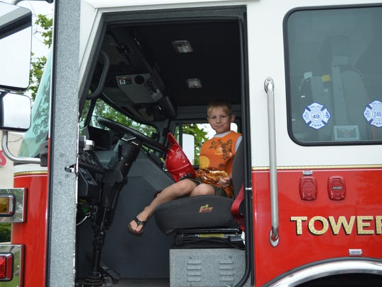 Andrey Bauman, 5, of Vineland sits in a Vineland Fire